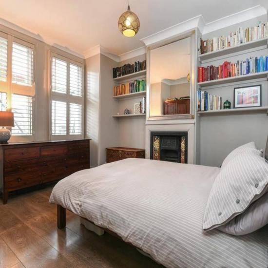 painting and decorating in bedroom in kentish town house