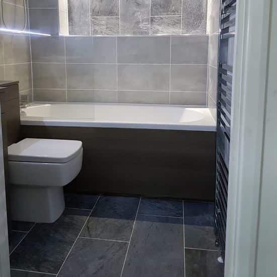 stylish bathroom in London grouted, tiled & applied with adhesive.
