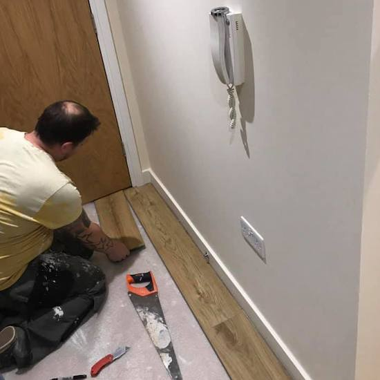 man painting and decorating in colliers wood flat