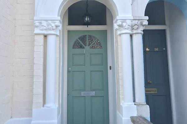 door of house in herne hill painted in green paint