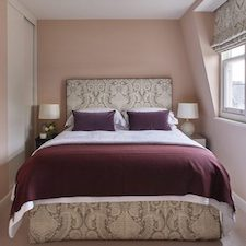 bedroom in house painted in pink paint by residential painters and decorators