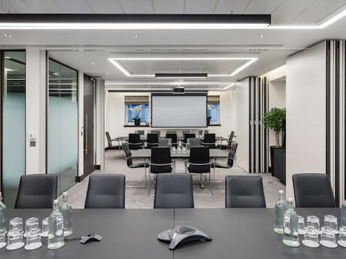 black meeting desks in white painted office meeting room