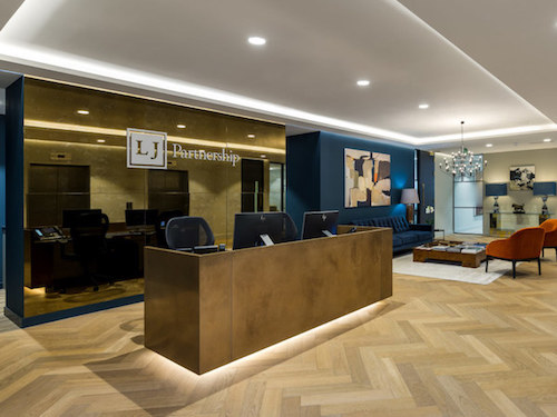 blue painted reception in LJ Partnership office in London