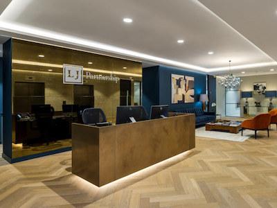 blue painted reception of LJ Partnership office