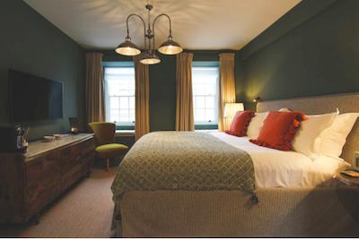 dark green painted hotel suite
