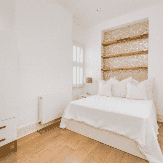 bedroom painted in white by our professional decorators in London