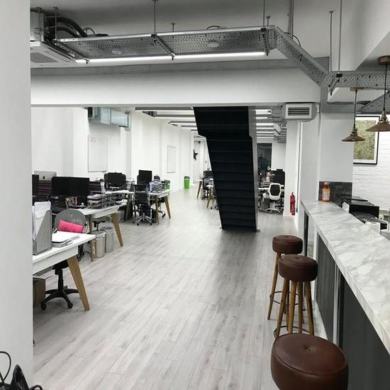 commercial painters and decorators in London transforming office area.