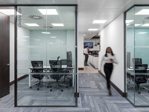 glass partitions in white painted office hallways
