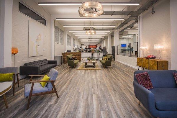 laminate flooring inside office meeting room painted in white