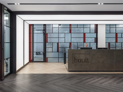office reception painted in white with dark hardwood flooring