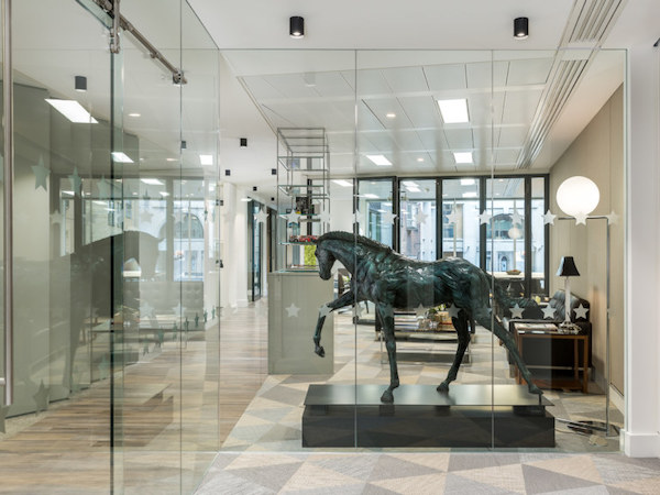 statue of horse in white painted office