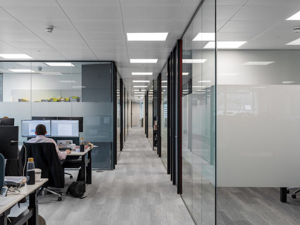 well-lit office meeting rooms painted in white