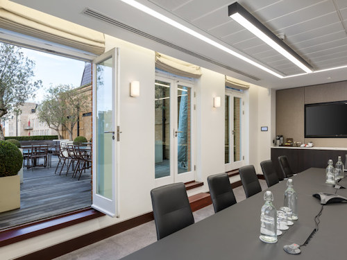 white painted walls in office meetin room with a view of London streets